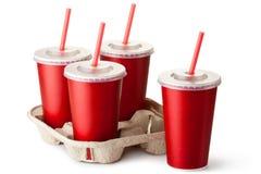 Quatro copos para viagem vermelhos com um suporte de copo Fotos de Stock