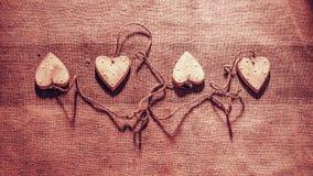 Quatro corações ligados junto com a corda Fotos de Stock