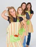 Quatro cozinheiros consideravelmente adolescentes Fotografia de Stock