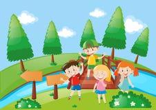 Quatro crianças no parque Fotografia de Stock