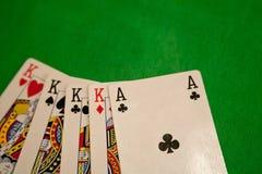 Quatro de um pôquer do tipo cardam a combinação na sorte verde da fortuna do jogo do casino do fundo Foto de Stock