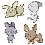 Quatro desenhos animados do coelho Imagens de Stock