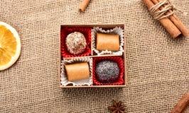 Quatro doces em uma caixa Fotografia de Stock Royalty Free