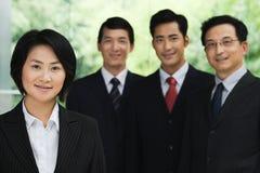 Quatro empresários chineses Fotografia de Stock