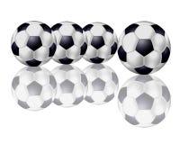 Quatro esferas de futebol em uma fileira Imagem de Stock Royalty Free
