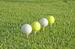 Quatro esferas do golfe. Fotos de Stock