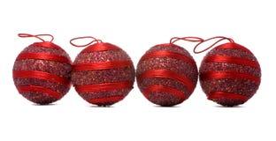 Quatro esferas vermelhas Fotos de Stock