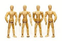 Quatro fantoches de madeira estão estando Imagens de Stock