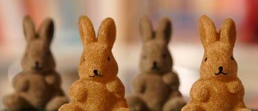 Quatro figuras do coelho Foto de Stock