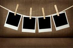 Quatro fotos imediatas em branco Fotografia de Stock