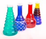 Quatro frascos da cor Fotografia de Stock Royalty Free