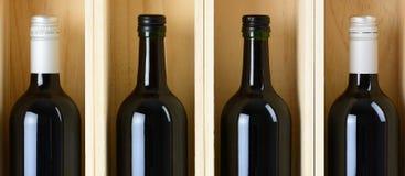Quatro frascos do vinho Fotos de Stock Royalty Free