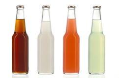 Quatro garrafas de soda sortidos, bebidas alcoólicas Foto de Stock Royalty Free