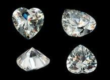 Quatro gemas da forma do coração isoladas em um preto ilustração royalty free