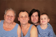 Quatro gerações nos vestidos Imagens de Stock Royalty Free