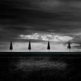 Quatro guarda-chuvas na praia Foto de Stock Royalty Free
