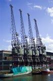 Quatro guindastes do porto Imagem de Stock