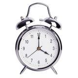 Quatro horas em um despertador redondo Fotografia de Stock