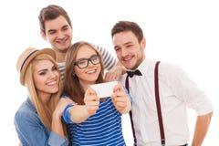 Quatro jovens à moda no fundo branco fotografia de stock royalty free