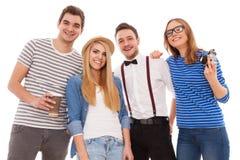 Quatro jovens à moda no fundo branco Foto de Stock