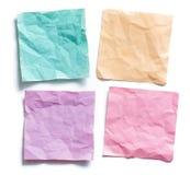 Quatro lembretes pegajosos amarrotados coloridos da nota Imagem de Stock