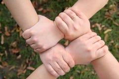 Quatro mãos Fotografia de Stock
