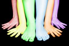 Quatro mãos e dois pés Fotos de Stock