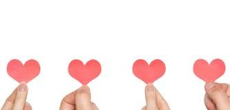 Quatro mãos quatro corações fotos de stock royalty free