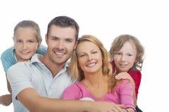 Quatro membros da família caucasianos felizes junto Imagem de Stock