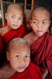 Quatro monges, Myanmar Foto de Stock Royalty Free
