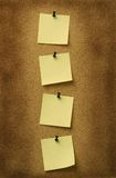 Quatro notas amarelas Imagem de Stock Royalty Free