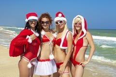 Quatro Papai Noel fotos de stock