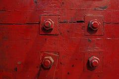 Quatro parafusos vermelhos Fotos de Stock