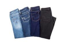 Quatro pares de calças de brim Imagem de Stock Royalty Free