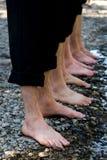 Quatro pares de pés molhados Fotografia de Stock Royalty Free
