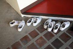 Quatro pares de sapatos Fotos de Stock Royalty Free