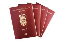 Quatro passaportes dinamarqueses Fotografia de Stock Royalty Free