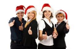 Quatro pessoas novas do negócio em chapéus do Natal fotos de stock royalty free