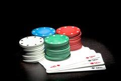Quatro pilhas de fichas coloridas Imagem de Stock