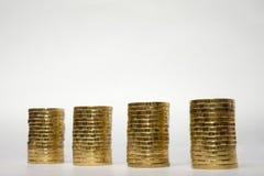 Quatro pilhas de moedas no fundo claro Fotografia de Stock Royalty Free