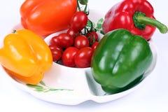 Quatro pimentas coloridas Fotografia de Stock