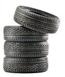 Quatro pneus pretos novos no branco Imagem de Stock