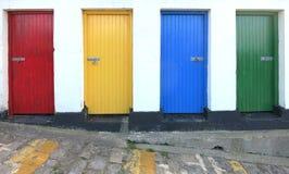 Quatro portas coloridas Fotos de Stock