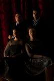 Quatro povos elegantes na noite Fotos de Stock Royalty Free