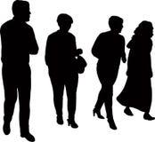 Quatro povos que andam junto, vetor da silhueta ilustração royalty free