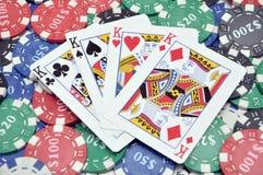 Quatro reis e microplaquetas do póquer Imagem de Stock Royalty Free