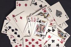 Quatro reis sobre o cartão de jogo velho Fotografia de Stock Royalty Free
