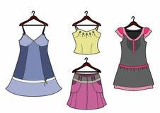 Quatro roupa em ganchos Fotografia de Stock Royalty Free