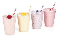 Quatro sabores de batidos do iogurte de fruto fotografia de stock