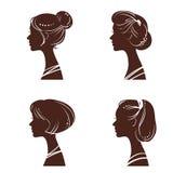Quatro silhuetas das mulheres Fotografia de Stock